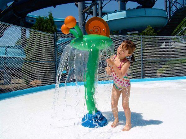 Plan a Visit - girl under snail water fountain