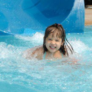 Happy Girl coming off water slide
